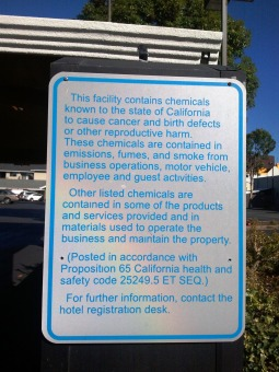 Palo Alto motel parking lot sign posted in accordance with California Proposition 65.